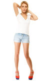 Summer fashion. Pretty sexy girl in denim shorts Stock Photo