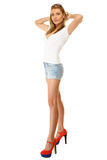 Summer fashion. Pretty sexy girl in denim shorts Royalty Free Stock Photos