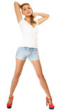 Summer fashion. Pretty sexy girl in denim shorts Stock Photography