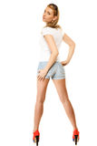 Summer fashion. Pretty sexy girl in denim shorts Royalty Free Stock Image