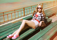 Summer fashion stylish girl posing in the city Stock Images