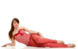 Summer fashion. Teenage girl in red outfit isolate. Summer fashion. Portrait of attractive woman teenage girl in red outfit lying on the floor isolated on white royalty free stock photo