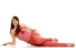 Summer fashion. Teenage girl in red outfit isolated. Summer fashion. Portrait of attractive woman teenage girl in red outfit lying on the floor isolated on white stock photography