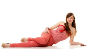 Summer fashion. Teenage girl in red outfit. Summer fashion. Portrait of attractive woman teenage girl in red outfit lying on the floor on white stock photos