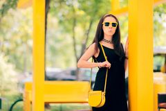 Summer Fashion Urban Woman with Matching Yellow Accessories royalty free stock image