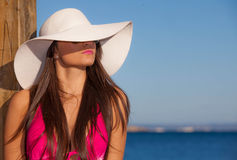 Summer fashion woman with beach hat. Royalty Free Stock Photography