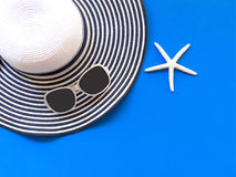 Summer Fashion woman big hat and accessories in the beach. Tropical sea.Unusual top view, colorfull background. Summer Concept Royalty Free Stock Photos