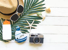 Summer Fashion woman big hat and accessories in the beach. Tropical sea.Unusual top view, white wood background. Summer Concept Royalty Free Stock Images
