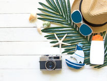 Summer Fashion woman big hat and accessories, camera and sunglasses go to travel in the beach. Tropical sea.Unusual top view,  bac Stock Photos