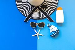 Summer Fashion woman big hat and sunglasses go to travel in the beach. Tropical sea.Unusual top view,  background. Summer Concept Stock Image