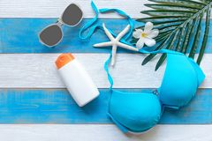 Summer Fashion woman blue swimsuit Bikini, starfish, sunblock, sun glasses and spa flower. Travel and vacations in the holiday, Stock Photography