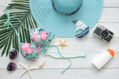 Summer Fashion woman swimsuit Bikini, camera, starfish, sunblock, sun glasses, hat. Travel and vacations in the holiday, Royalty Free Stock Photo