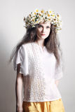 Summer fashion young woman in white wreath of flowers. Summer fashion woman Young woman in white with wreath of flowers Chamomile floral chaplet stock photos