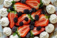 Summer strawberries, meringues and blackberries cake stock photo