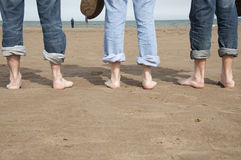 Summer feet. Family walking on a beach in a warm and sunny day Royalty Free Stock Photos