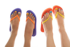 Summer feet with flip flops. Black and white summer feet with colorful flip flops Royalty Free Stock Photos