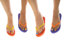 Summer feet with flip flops. Black and white summer feet with colorful flip flops stock images
