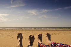 Summer Feet on Formby Beach. Giving the feet some sun on a quiet day at Formby Beach Stock Image