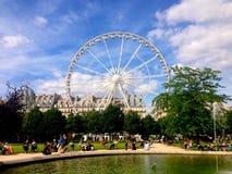 Summer Ferris Wheel. View from Jardin De Tuilieries in Paris, France stock photos