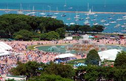 Summer Festival At the Lakefront. Aerial view of a crowd of revelers gathering at Chicago's Grant Park during the Taste of Chicago Stock Image