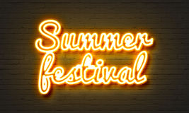 Summer festival neon sign on brick wall background. Summer festival neon sign on brick wall background Royalty Free Stock Photo