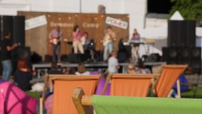 Summer festive event with stage and artists is in open air in city. stock video