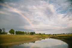 Summer field landscape after rain with rainbow. Eastern Europe, Ukraine stock photography