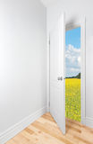 Summer field seen through the open door Stock Images