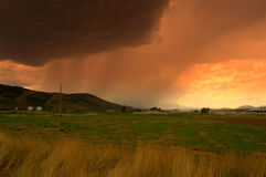 Summer fields storm sunset Royalty Free Stock Image