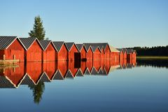 Summer in Finland. Rad boat houses in the evening sun in Finland Royalty Free Stock Image