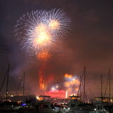 Fireworks over boats in harbor Royalty Free Stock Photography