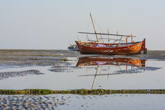 Summer fishing boat at beach and reflection in water. India Royalty Free Stock Image