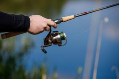 Summer fishing on the river bank. Fishing background royalty free stock photo