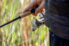 Summer fishing on the river bank. Fishing background royalty free stock images