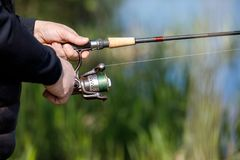 Summer fishing on the river bank. Fishing background royalty free stock image