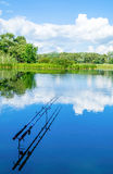 Summer fishing on the river with fishing rods Royalty Free Stock Images