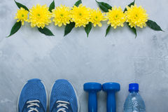 Summer flatlay composition with sport equipment and flowers stock photography