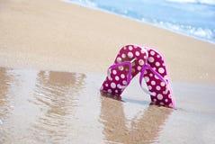 Summer, flip flop on feet, beach. Summer, flip flop, sun light on water Royalty Free Stock Photo