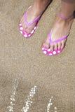 Summer, flip flop on feet, beach. Summer, flip flop on feet, sun light on water Stock Photos