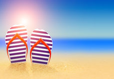 Summer flip flops on the beach Royalty Free Stock Photo
