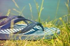 Summer Flip Flops on Grass Beach Stock Image