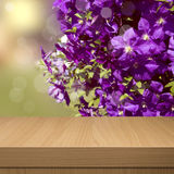 Summer floral background with empty wooden table. Floral summer Royalty Free Stock Photos