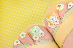 Summer flower pedicure. Royalty Free Stock Image