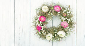 Summer flower wreath on white wooden background. Pink and white summer flower wreath on white wooden rustic background Royalty Free Stock Photos