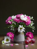 Summer flowers in a ceramic vase. Stock Photos