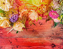 Summer flowers on red wooden background, top view, place for text Stock Photo