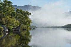Summer foggy landscape with river. Kamchatka Peninsula, East Coast. royalty free stock image