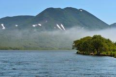 Summer foggy landscape with river. Kamchatka Peninsula, East Coast stock photography