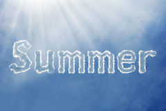 Summer font cloud on a blue sky. Summer word on a blue sky with edge light Royalty Free Stock Images