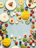 Summer food background with various fresh fruits and berries, top view, frame royalty free stock photo
